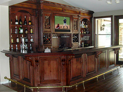 custom basement bars. This bar is a combination of back wall cabinets  sink and front surround Extra trim finish include inset recessed skin panels Custom built home ideas in Ohio